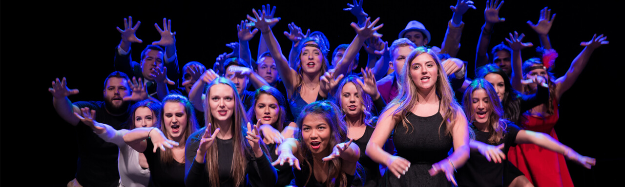 Group photo of fraternity and sorority members performing a lip sync routine